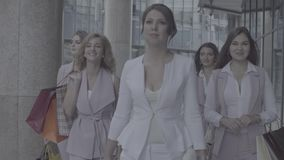 Portrait of business women walking in the city. Close up portrait of five attractive business women walking near business centre. Summer day. No grading version stock video
