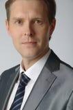 Portrait of businessman. Portrait of middle age businessman in austere suit Royalty Free Stock Photos