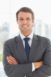 Portrait of a businessman with arms crossed outdoors Royalty Free Stock Image
