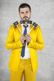 Portrait of businessman asking for help. Wearing a gold suit Royalty Free Stock Photography