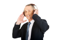 Portrait of businessman with big headphones Royalty Free Stock Image