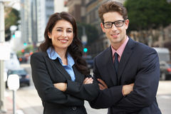 Portrait Of Businessman And Businesswoman Outside Office Royalty Free Stock Photography