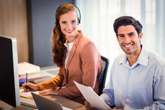 Portrait of businessman and businesswoman smiling Royalty Free Stock Photos