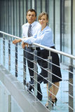 Portrait of businessman and businesswoman standing by railing Stock Photography