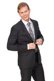 Businessman Buttoning Suit Jacket Royalty Free Stock Photos