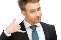 Portrait of businessman cellphone gesturing Royalty Free Stock Photo