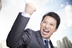 Portrait of Businessman Cheering with Fist raised, Outdoors, Beijing Royalty Free Stock Image