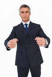 Portrait of a businessman clenching fists. On white background Stock Image