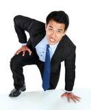Portrait of businessman climb the wall Royalty Free Stock Photos