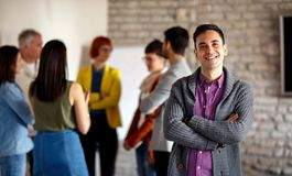 Portrait of businessman with colleagues royalty free stock image