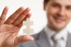 Portrait Businessman connecting puzzle pieces. Concept. in a studio. Stock Image