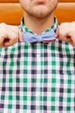 Portrait of businessman correcting his bowtie Royalty Free Stock Photography