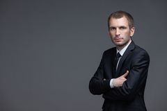 Portrait of businessman with crossed hands Royalty Free Stock Photos