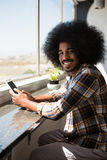 Portrait of businessman with curly hair using digital tablet Stock Images