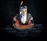 Portrait of businessman with diving equipment in water Royalty Free Stock Images