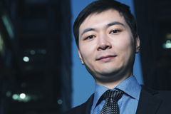 Portrait of businessman at dusk, Beijing Stock Photo
