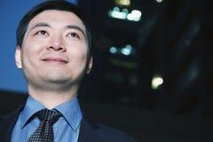 Portrait of businessman at dusk, Beijing Stock Image