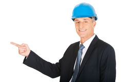 Portrait businessman engineer pointing to the left Stock Images