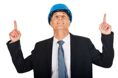 Portrait of businessman engineer pointing up Stock Photo
