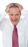 Portrait of businessman expressing frustration Royalty Free Stock Photography