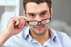 Portrait of businessman in eyeglasses at office Stock Photography