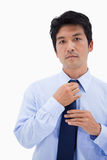 Portrait of a businessman fixing his tie Royalty Free Stock Image