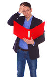 Portrait of businessman with folder, isolated Royalty Free Stock Image