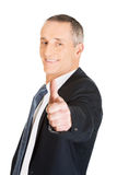 Portrait of businessman gesturing ok sign Royalty Free Stock Photos