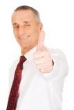 Portrait of businessman gesturing ok sign Stock Photography
