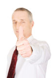 Portrait of businessman gesturing ok sign Stock Image
