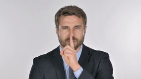 Portrait of Businessman Gesturing  Silence, Finger on Lips stock footage