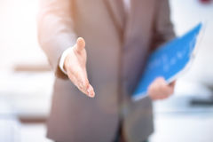 Portrait of a businessman giving a hand. Portrait of a successful businessman giving a hand Royalty Free Stock Photo