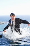Portrait of a businessman going out of the water Royalty Free Stock Photos