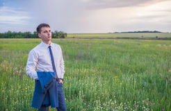 Portrait of businessman on a green meadow Royalty Free Stock Photo
