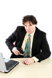 Portrait Of Businessman With Gun Over White Background royalty free stock photography