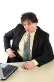 Portrait Of Businessman With Gun Over White Background royalty free stock image