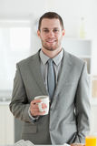 Portrait of a businessman having breakfast Stock Photos