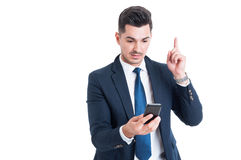 Portrait of businessman having an idea and pointing finger up Royalty Free Stock Images