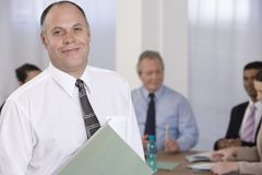 Portrait of businessman and his team. Stock Images