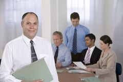Portrait of businessman and his team. Royalty Free Stock Photo