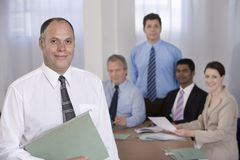 Portrait of businessman and his team. Royalty Free Stock Image