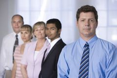 Portrait of businessman and his team. Stock Photography
