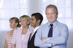 Portrait of a businessman and his team. Stock Images