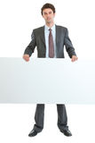 Portrait of businessman holding blank billboard stock photos