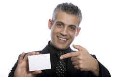Portrait of a businessman holding a blank business card Royalty Free Stock Images