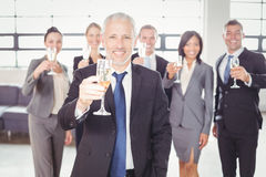 Portrait of businessman holding champagne flute Stock Photography