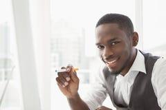 Portrait of a businessman holding cigarette Stock Photo