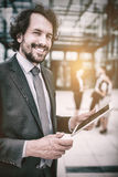 Portrait of businessman holding digital tablet Stock Photo