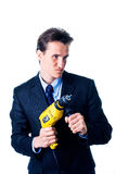 Portrait of businessman holding drill Royalty Free Stock Photos