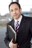 Portrait of a businessman holding a leather case with briefing papers Royalty Free Stock Photo